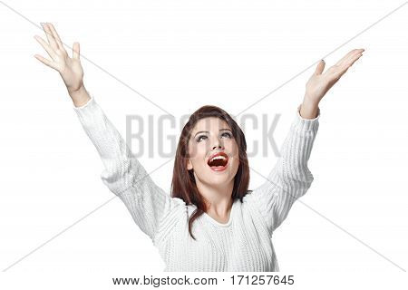 portrait of young happy woman with hands up isolated on white background in photostudio