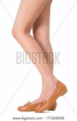 Woman beautiful long legs and healthy skin standing legs pose wearing vintage fashion leather shoes Isolated on white background.