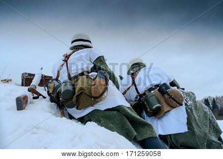 Wehrmacht machine-gun crew. Reconstruction of the winter defensive battles of the Red Army in WWII (1944 year).