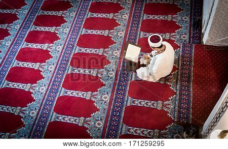 Turkish imam is reading Quran on the mosque high quality and high resolution shoot