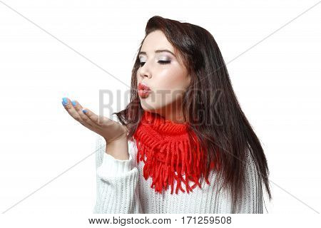 portrait of young woman blowing on palm isolated on white in photostudio
