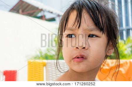 Girl with tomato sauce on her messy mouth