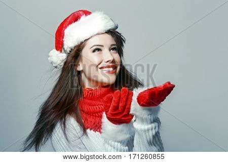 young beautiful woman waiting for the snow falling