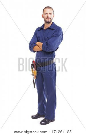 Young worker standing with arms crossed on white background - full body