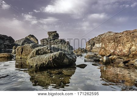 Rock and boulder on the coast of the Aegean Sea in Greece