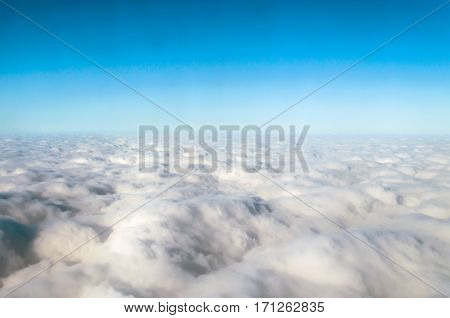 Clouds cumulus from above the sky blue flight