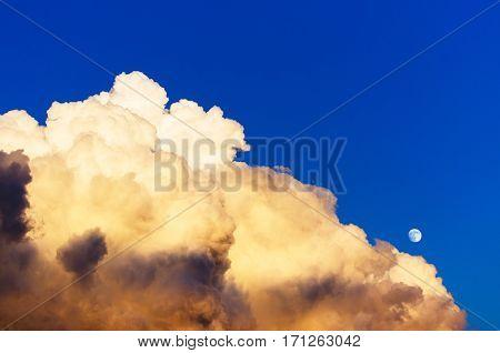 Cumulus thunder clouds evening sunset sky moon