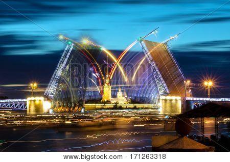 Russia, Saint Petersburg Night view of Palace Bridge drawbridge, and the Peter and Paul Fortress