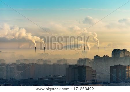 Cities and industrial smoke clouds the sky