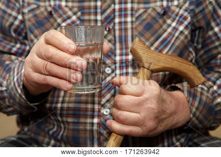 Old man holding a glass of water. Senior people health care
