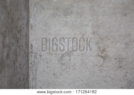 Old grungy texture grey concrete wall . Abstract gray interior with concrete wall . Vintage style angle at room.