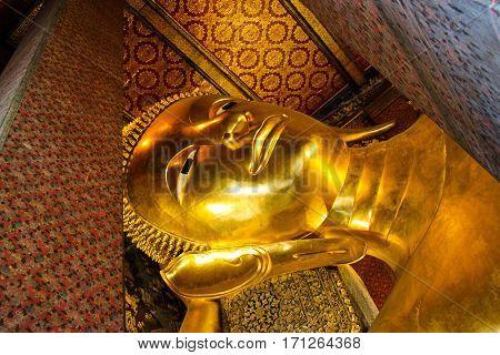 The Big golden Reclining Buddha at Wat Pho in Bangkok Thailand.