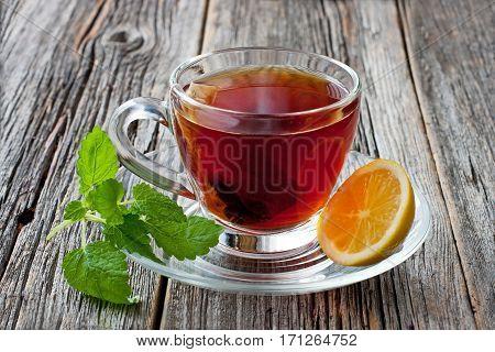 Hot tea with lemon. Healthy drink. Hot winter beverage concept