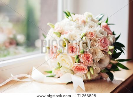 Bouquet on the windowsill. The concept of marriage and love.