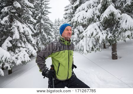 Happy Man Hiker Traveling In The Winter Mountains