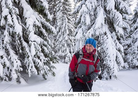Traveler Man Enjoying A Wonderful Adventure In The Winter Mountains