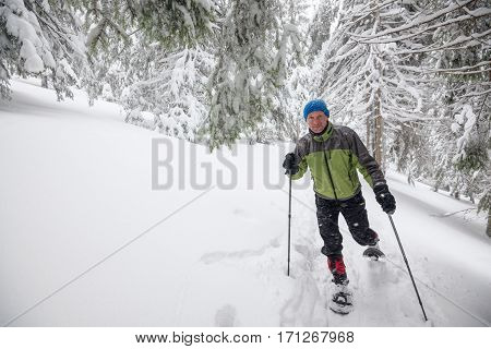 Joyful Traveler Running Snowshoeing In Deep Snow