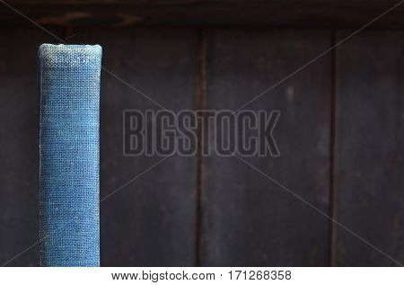 Blue antique book spine on old wooden bookshelf background