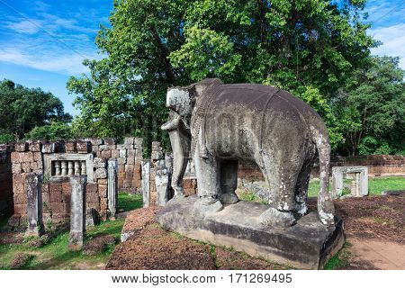 sculpture of an elephant and ruins at East Mebon temple