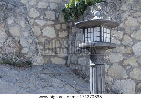 horizontal view of an iron lamppost on a nice stone corner of the street
