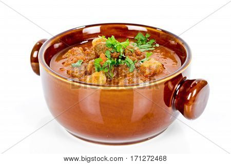 goulash soup in bowl isolated on white
