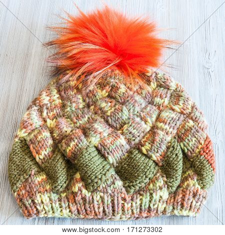Hand Knitted Beanie With Orange Pompon