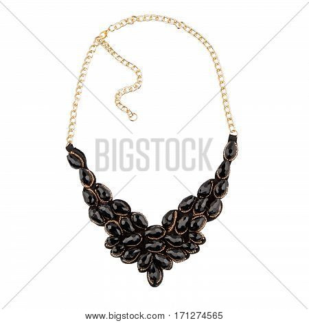 Golden necklace with onyx on white background