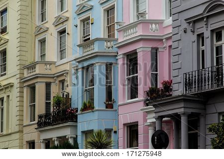 LONDON, GREAT BRITAIN - SEPTEMBER 20, 2014: This is architecture and multi-colored coloring houses in the now prestigious district of Notting Hill.