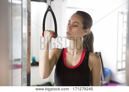 Attractive Young Woman Working Out On Weight-lifting Training Machine
