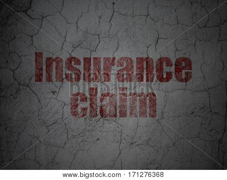 Insurance concept: Red Insurance Claim on grunge textured concrete wall background