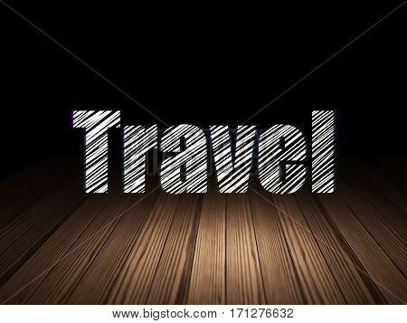 Vacation concept: Glowing text Travel in grunge dark room with Wooden Floor, black background