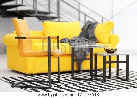 Modern living room interior with yellow sofa