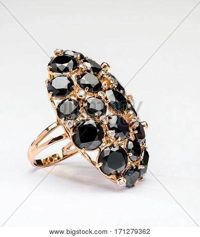 Jewelry, a ring on his hand with black stones