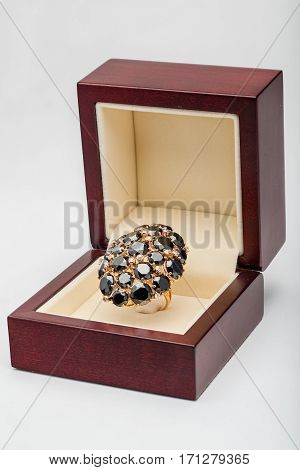 Jewelry rings with black stones in a box