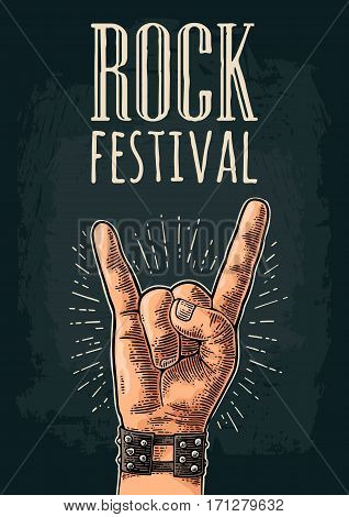 Rock and Roll sign. Hand with metal spiked bracelet giving the devil horns gesture. Vector color vintage engraved illustration. Isolated on white background. For festival poster
