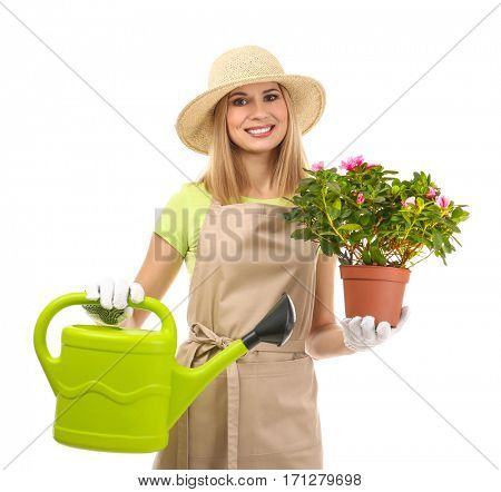 Beautiful woman florist holding house plant and watering can on white background