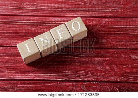 Wooden Toy Cubes On A Red Wooden Table