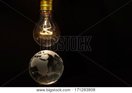 Light bulb and earth concept of global issues Europe Africa