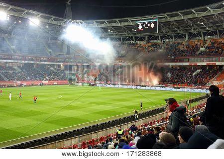 MOSCOW - OCT 23, 2016: Smoke in stands during football match Lokomotiv - CSKA on Locomotive stadium