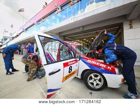 MOSCOW - SEP 3, 2016: Mechanics near car during Race of Stars At wheel Magazine with participation of best Russian riders at Moscow Raceway