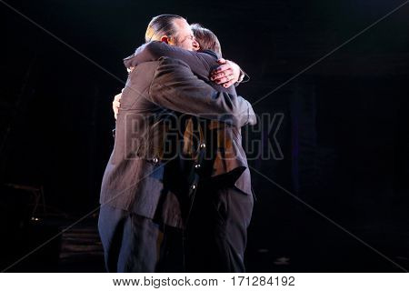 MOSCOW - OCT 13, 2016: Two actors embrace on stage during Dancings Performance in Modern theater