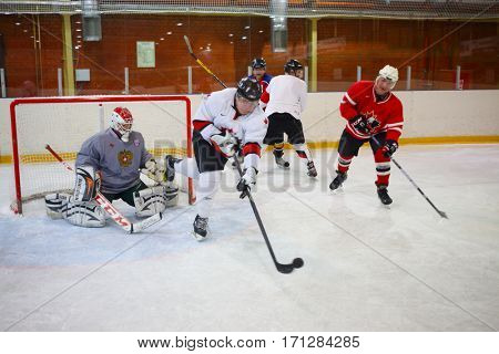 MOSCOW - SEP 5, 2016: Nonpro men play hockey in ice palace in Novokosino