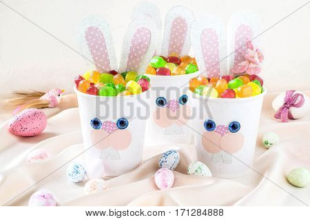 Homemade making of boxes from paper cups for sweets and candy in form of Easter hare. Present children. DIY concept. Step by step photo instructions. Step 7. Boxes in form of Easter hare with candy