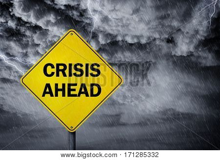 Crisis ahead sign in a rain storm concept for financial problems, risk and economic depression