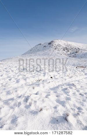 Snow covered mountain in winter with blue sky