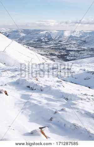 Snow covered valley in winter Edale Peak District UK