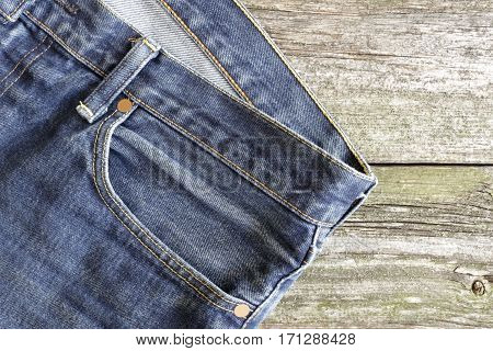 Jeans pocket for on old wooden background