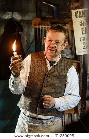 TELFORD UK - CIRCA 2013: Candlemaker at Blists Hill Victorian Museum Ironbridge UK