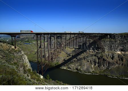Traffic Big Trucks Transportation Driving Over Bridge Spanning Canyon and River