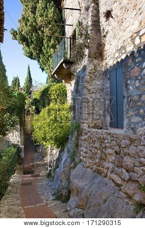 Narrow walkways and stone homes within Eze, France.